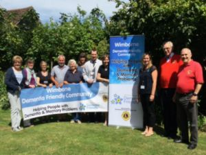 Lions Club members wih Wimborne Dementia Friends representatives at the presentation of their banners
