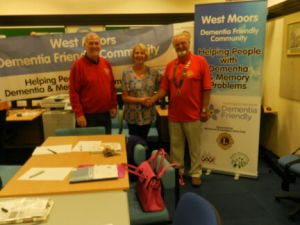 Lions Club members wih a West Moors Dementia Friends representative making use of their banners